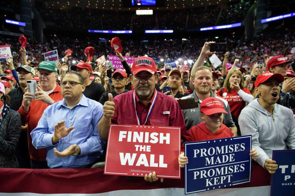 TOPSHOT - Supporters cheer as US President Donald Trump speaks during a campaign rally at the Toyota Center in Houston, Texas, October 22, 2018. (Photo by SAUL LOEB / AFP)SAUL LOEB/AFP/Getty Images