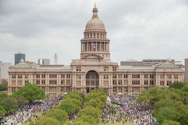 """FILE - In this March 24, 2018, file photo, thousands of people gather on the grounds of the Texas State Capitol during a """"March for Our Lives"""" rally in Austin, Texas. The vast majority of mass shooters have acquired their firearms legally with nothing in their background that would have prohibited them from possessing a gun. But there have been examples of lapses in the background check system that allowed guns to end up in the wrong hands. Very few states also have a mechanism to seize firearms from someone who is not legally allowed to possess one.(Nick Wagner/Austin American-Statesman via AP, File)"""