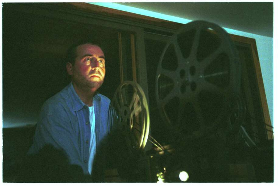 Andy Lehrfeld of Stamford runs the projector at his home in September 2002 at a gathering of the Stamford chapter of the International Laurel & Hardy Appreciation Society. Photo: Hearst Connecticut Media File Photo