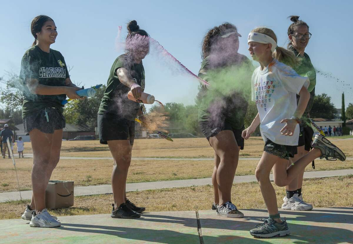 Midland College softball players provided extra color at stations around the park as children from around the area participate 09/07/19 in the YMCA Kids Color Fun Run at Tumbleweed Park. Tim Fischer/Reporter-Telegram