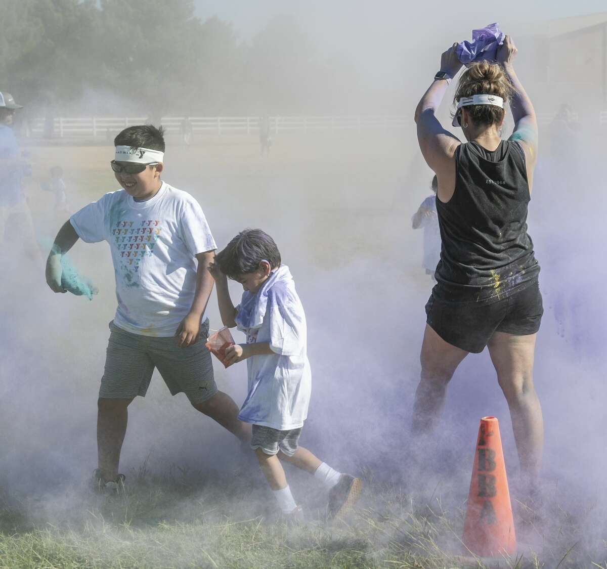 Children from around the area participate 09/07/19 in the YMCA Kids Color Fun Run at Tumbleweed Park. Tim Fischer/Reporter-Telegram
