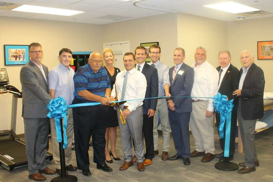 Hartford HealthCare Rehabilitation Network in Cromwell held a grand opening Aug. 21. From left are Middlesex County Chamber of Cromwell Division Rodney Bitgood, Cromwell Director of Planning and Development Stuart Popper, Town Manager Tony Salvatore, Renee Bouchard, physical therapist Nick McCool, Gregory Zimbelman, state Sen. Matt Lesser, VP of Operations Chris Carlin, Chamber Chairman Don DeVivo, immediate past chairman Jay Polke and Chamber President Larry McHugh. Photo: Contributed Photo
