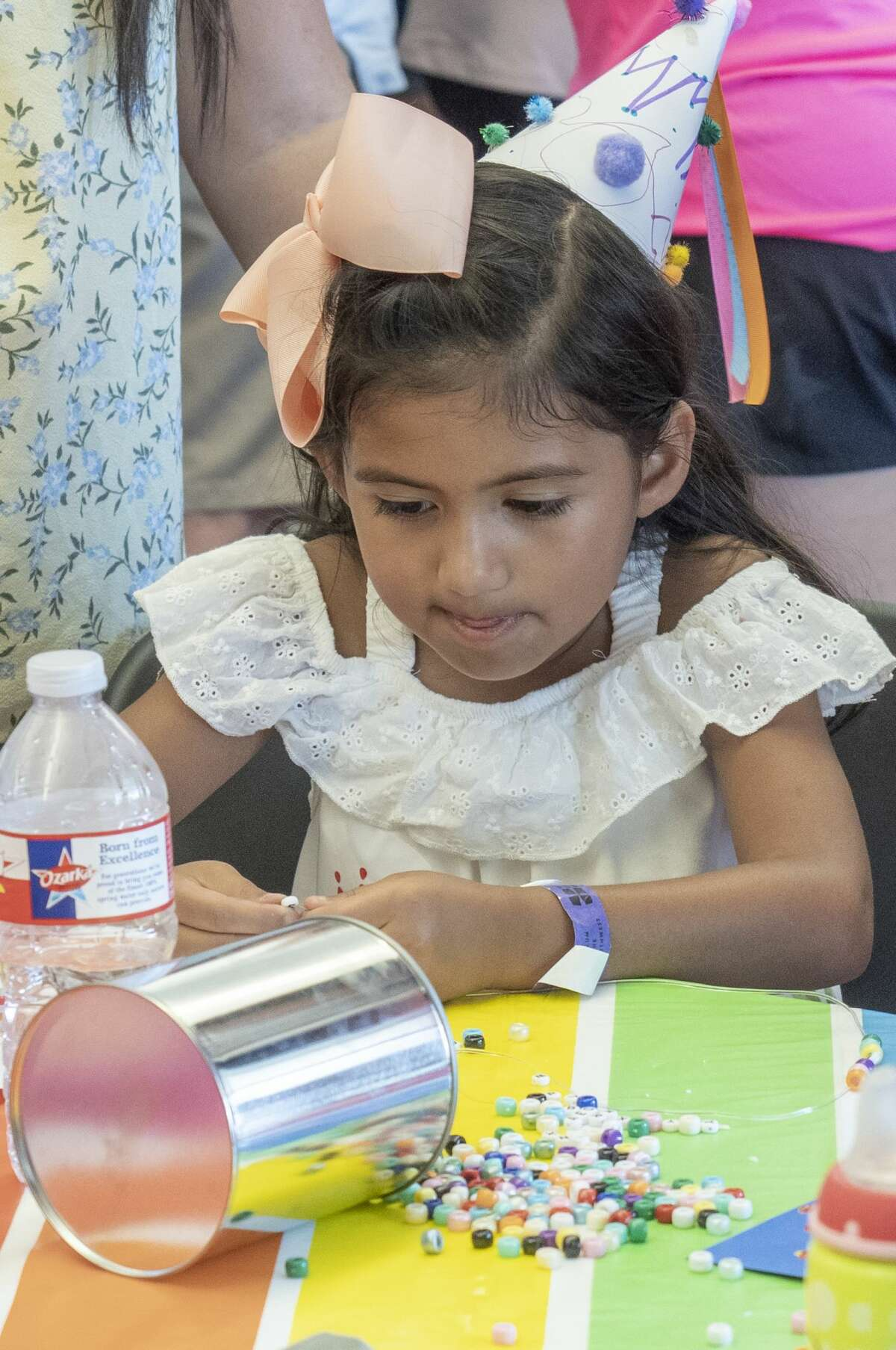 Emma Claire Guzman works on making a necklace in the kinderfest area 09/07/19 during Septemberfest at Museum of the Southwest. Tim Fischer/Reporter-Telegram