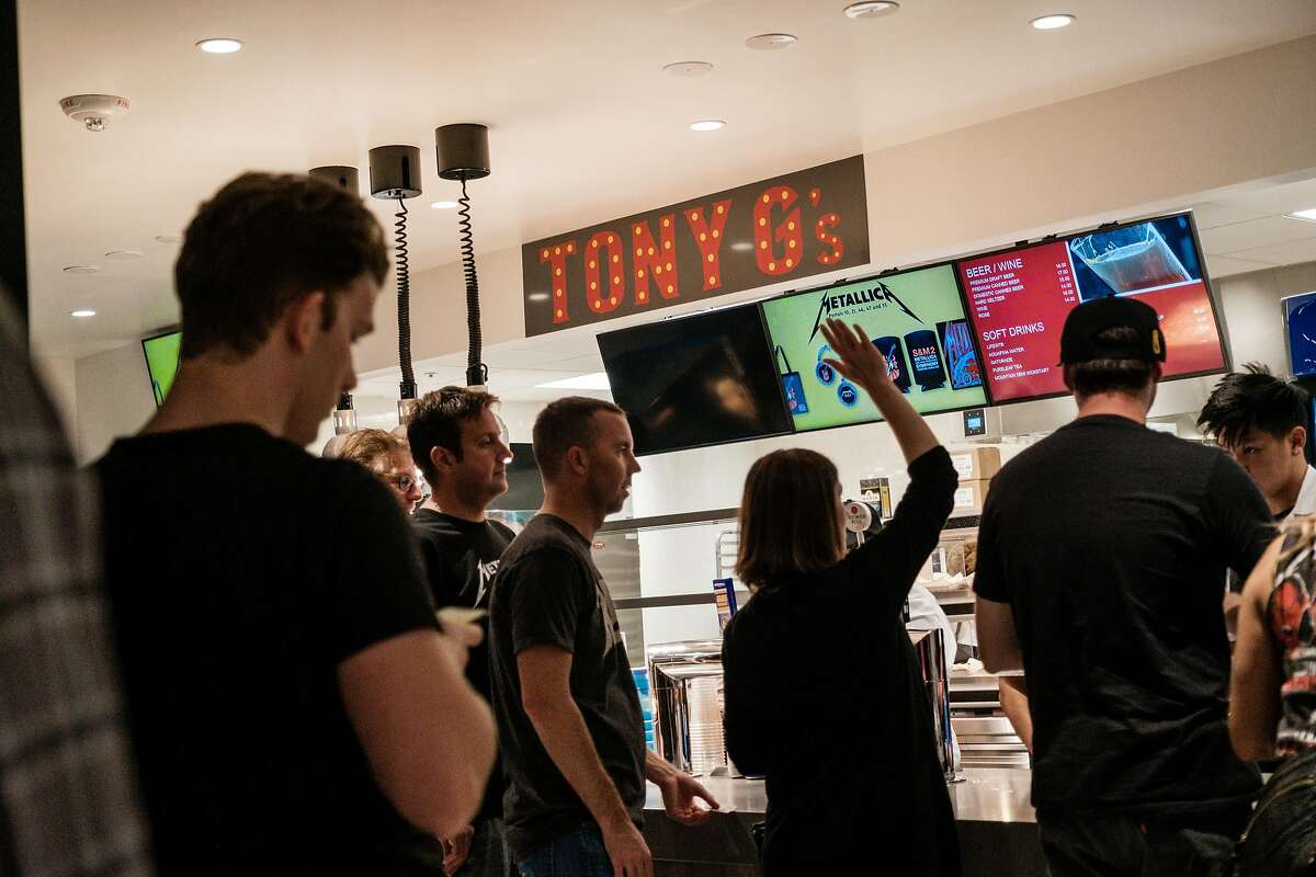 People wait in line at Tony G's on the main concourse during a Metallica concert last year.