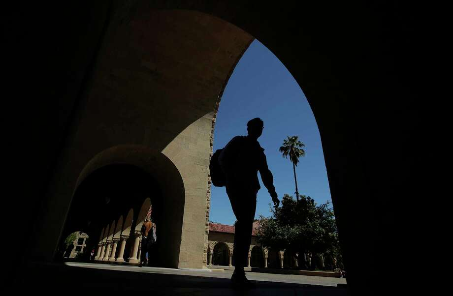 FILE - In this April 9, 2019, file photo, pedestrians walk on the campus at Stanford University in Stanford, Calif. College students who earned money this summer can make the most of it by including a few longer-term financial goals in their budgeting. (AP Photo/Jeff Chiu, File) Photo: Jeff Chiu / Copyright 2019 The Associated Press. All rights reserved.