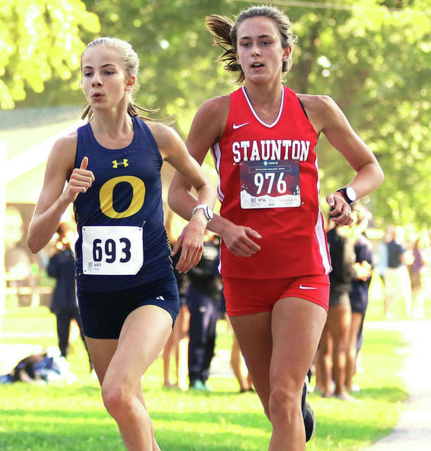 O'Fallon's Peyton Schieppe (left) and Staunton's Lydia Roller run together on the lead midway through the 3-mile Granite City Invitational girls cross country race Saturday morning at Wilson Park in Granite City. Schieppe won the race, with Roller in second. Photo: Greg Shashack | The Telegraph