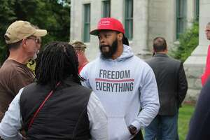 The Connecticut Citizens Defense League organized a gun rights rally at the state Capitol in Hartford on Saturday opposing gun control measures proposed in Congress. Above, keynote speaker Maj Toure, founder of Black Guns Matter, from Phildelphia, talking with fellow rallyers after he spoke.