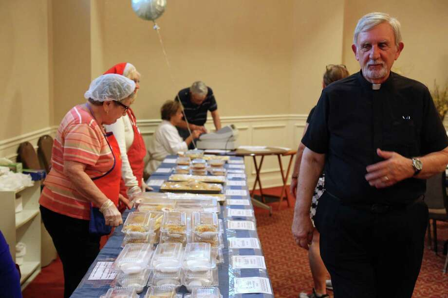 Rev. George Coca admires the selection of homemade Greek desserts at the St. Dimitrie Orthodox Church's 40th annual Fall Festival on Friday, Sept. 6, 2019, in Easton, Conn. Photo: Jarret Liotta / Jarret Liotta / ©Jarret Liotta