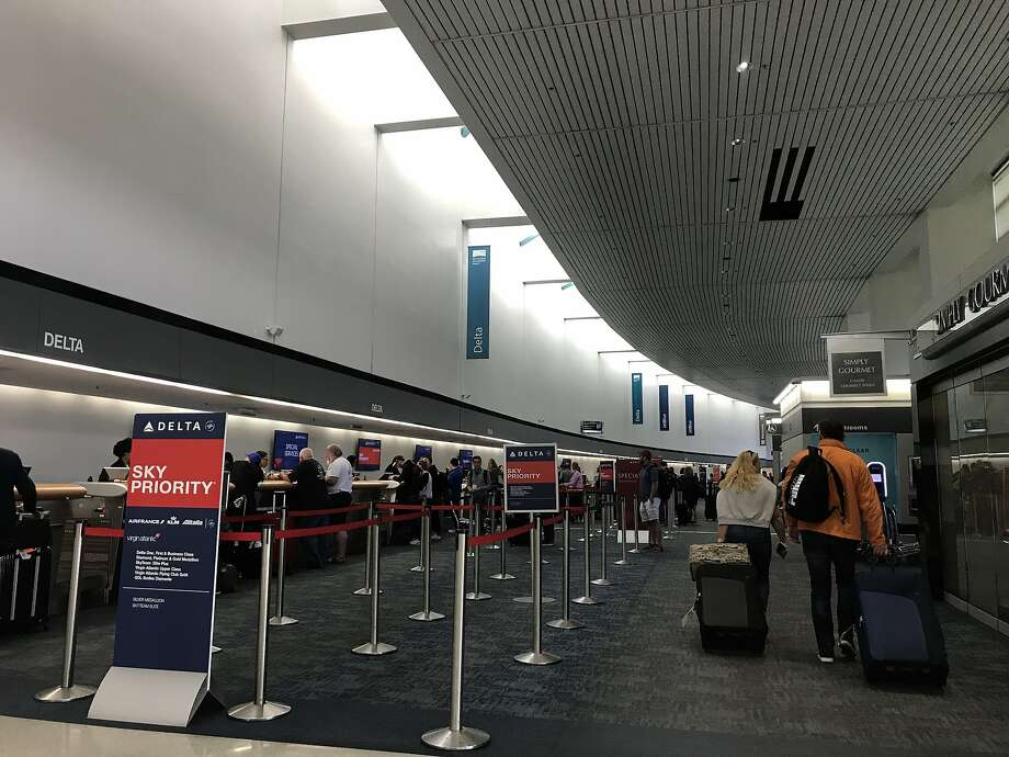 Travelers walk through the ticketing section of Terminal 1 at San Francisco International Airport onSaturday, Sept. 7, 2019. Saturday marked the start of construction on the airport's busiest runway section, which delayed 160 flights, canceled 89 flights, and caused snaking lines of restless travelers. Photo: Lauren Hernandez / The Chronicle