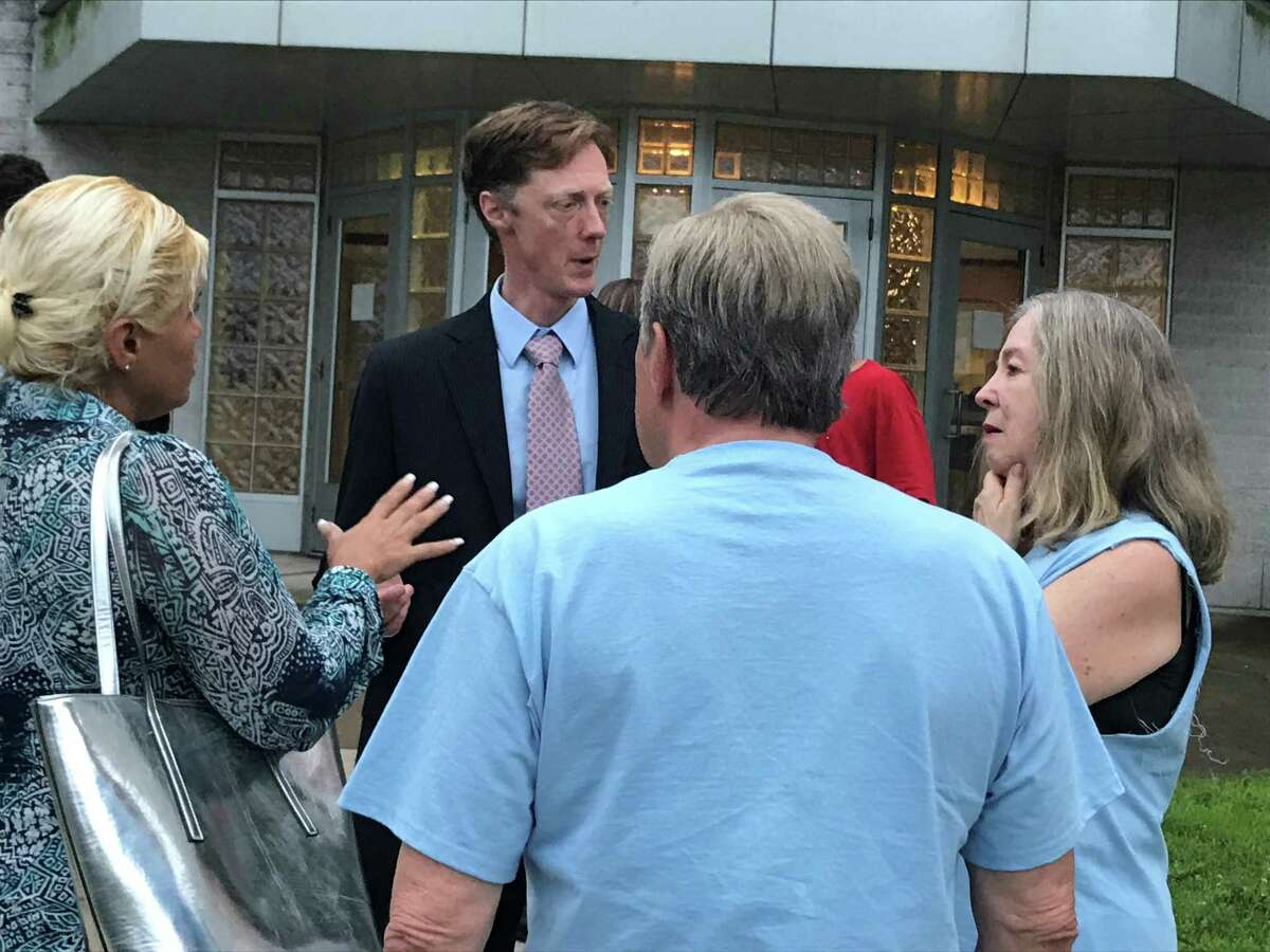 Then-mayoral candidate Justin Elicker speaks with supporters outside Hill Regional Career High School July 18, 2019.