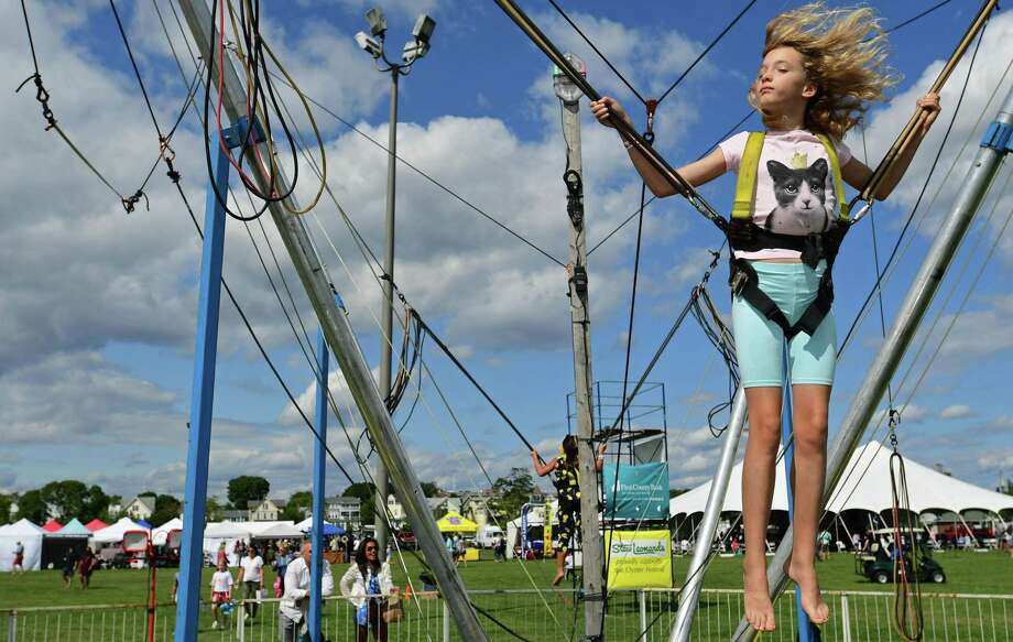 Chloe Jarvis, 9, of Norwalk enjoy the Bungee Jump during the Norwalk Seaport Association 42nd annual Oyster Festival Saturday, September 7, 2019, in Norwalk, Conn. Last year, other non-profit organizations raised more than $200,000 at the Norwalk Seaport Association Oyster Festival. Photo: Erik Trautmann / Hearst Connecticut Media / Norwalk Hour