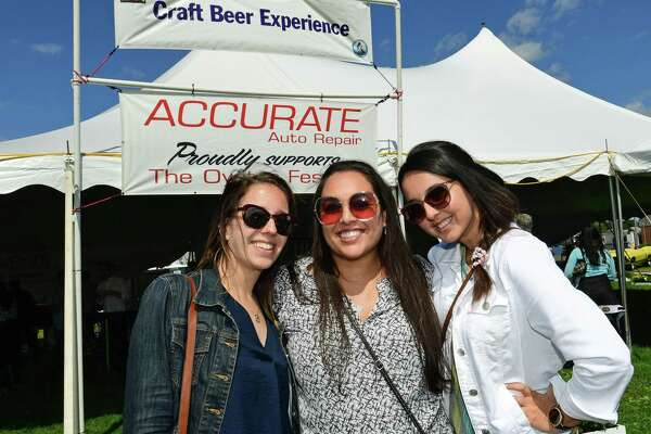 Courtney Sawicki of Norwalk and her friends Sanchi Baghela and Isabel Peixoto enjoy the Norwalk Seaport Association 42nd annual Oyster Festival Saturday, September 7, 2019, in Norwalk, Conn. Last year, other non-profit organizations raised more than $200,000 at the Norwalk Seaport Association Oyster Festival.