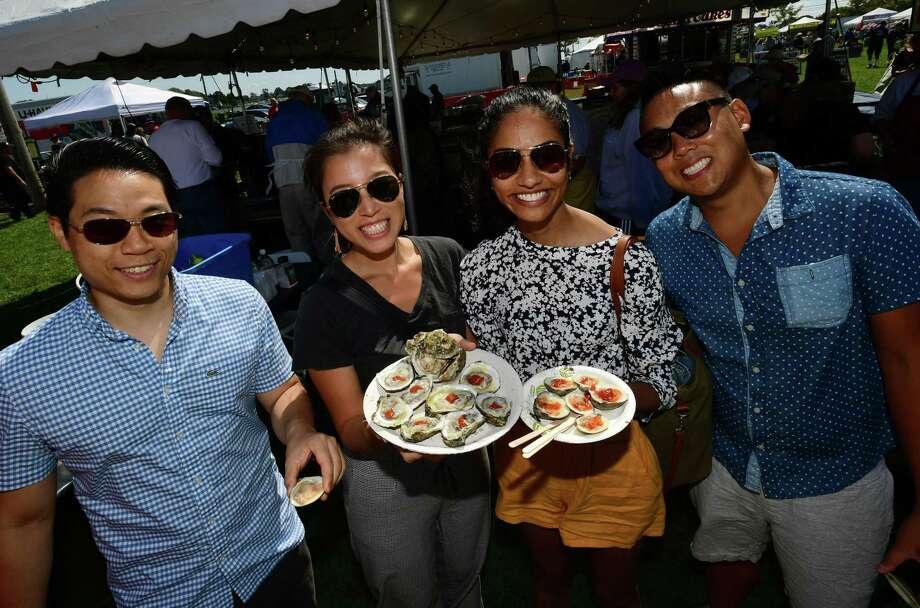 Visitors including Chooey Kua, Christina Fang, Manasa Kannegani and Jonathan Lee of NYC enjoy the Norwalk Seaport Association 42nd annual Oyster Festival Saturday, September 7, 2019, in Norwalk, Conn. Last year, other non-profit organizations raised more than $200,000 at the Norwalk Seaport Association Oyster Festival. Photo: Erik Trautmann / Hearst Connecticut Media / Norwalk Hour