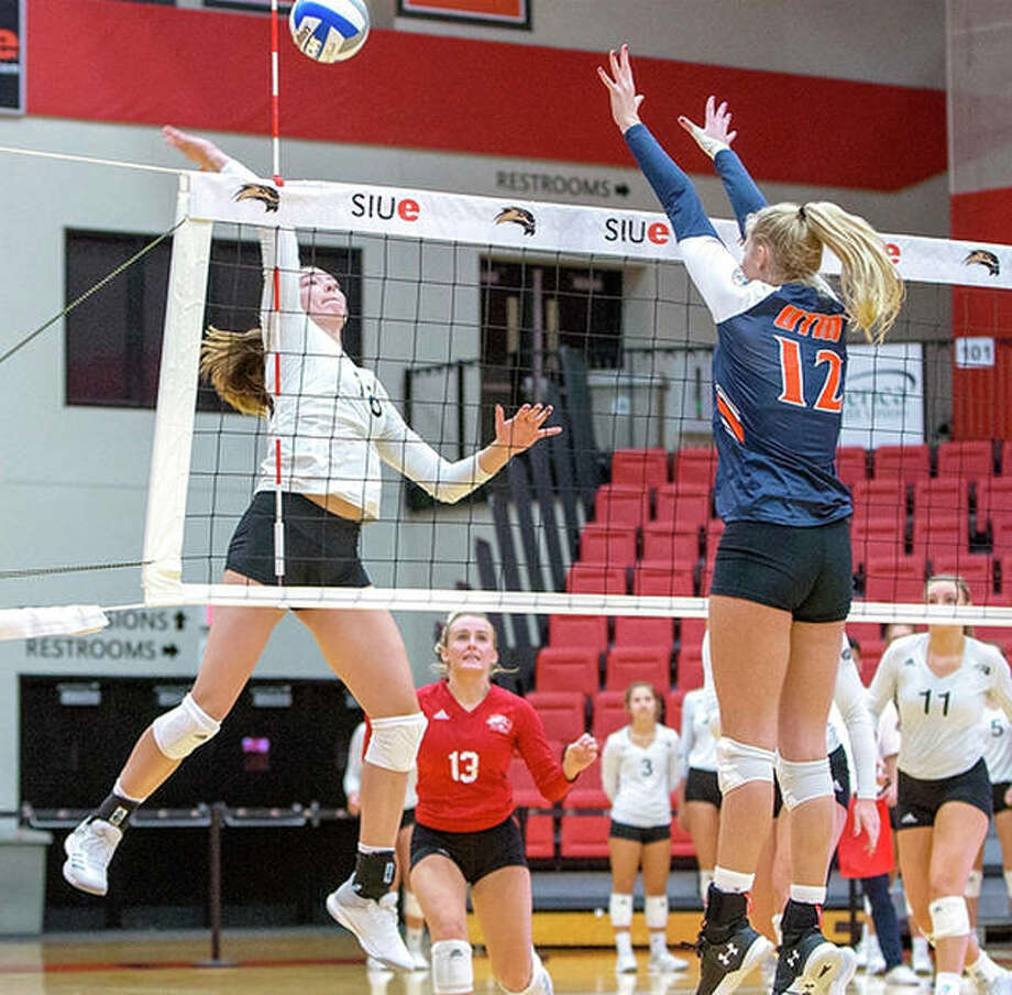 Annie Ellis of SIUE, left, nine kills, hit .583 and led the team in blocks with three in the cougars' sweep of Alabama A&M which locked up the title of the Saluki Bash Saturday at SIU Carbondale. Photo: SIUE Athletics