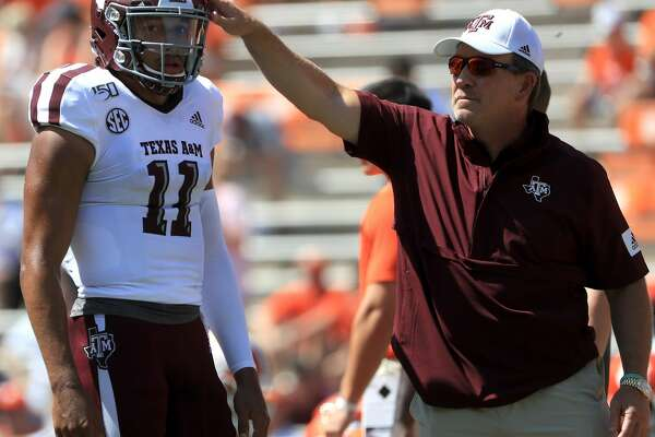 CLEMSON, SOUTH CAROLINA - SEPTEMBER 07: Head coach Jimbo Fisher stands alongside his quarterback Kellen Mond #11 of the Texas A&M Aggies before their game against the Clemson Tigers at Memorial Stadium on September 07, 2019 in Clemson, South Carolina. (Photo by Streeter Lecka/Getty Images)