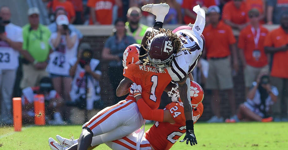 Texas A&M's Kendrick Rogers, top, is tackled by Clemson's Derion Kendrick (1) and Nolan Turner during the first half of an NCAA college football game Saturday, Sept. 7, 2019, in Clemson, S.C. (AP Photo/Richard Shiro) Photo: Richard Shiro/Associated Press / Copyright 2019 The Associated Press. All rights reserved