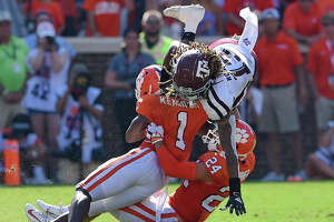 Texas A&M's Kendrick Rogers, top, is tackled by Clemson's Derion Kendrick (1) and Nolan Turner during the first half of an NCAA college football game Saturday, Sept. 7, 2019, in Clemson, S.C. (AP Photo/Richard Shiro)