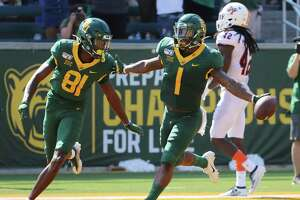 Baylor cornerback Grayland Arnold, right, celebrate with wide receiver Tyquan Thornton, after his punt return touchdown against UTSA in the first half of an NCAA college football game, Saturday, Sept. 7, 2019, in Waco, Texas. (Rod Aydelotte/Waco Tribune-Herald via AP)