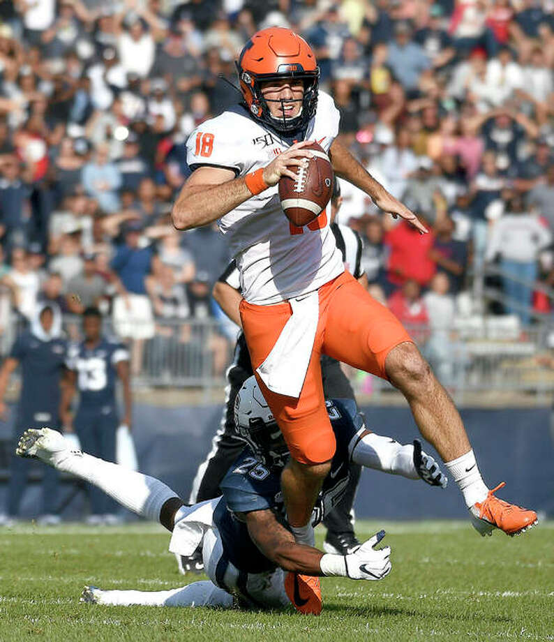 Illinois quarterback Brandon Peters (18) breaks free from Connecticut defensive back Tyler Coyle during the first half Saturday's game in East Hartford, Conn. Photo: AP Photo