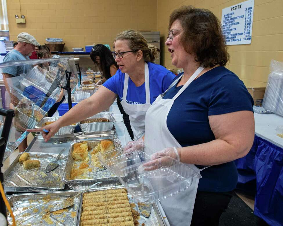 Panagiota Giakoumis and Janet Jenkins Giakoumis sell pastries during the 44th annual St. George's Greek Festival at the St. George's Orthodox Church on Clinton Street in Schenectady on Saturday, Sept. 7, 2019 (Jim Franco/Special to the Times Union.)