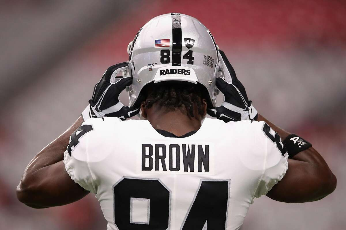 Wide receiver Antonio Brown, briefly of the Oakland Raiders, adjusts his helmet before the NFL preseason game against the Arizona Cardinals at State Farm Stadium on August 15, 2019 in Glendale, Arizona.