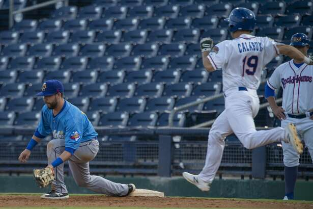 RockHounds' Chase Calabuig tries to beat the throw to first but Amarillo's Peter Van Gansen gets the out 09/07/19 as the RockHounds take on the Amarillo Sod Poodles in game 4 of the Texas League Division playoff. Tim Fischer/Reporter-Telegram