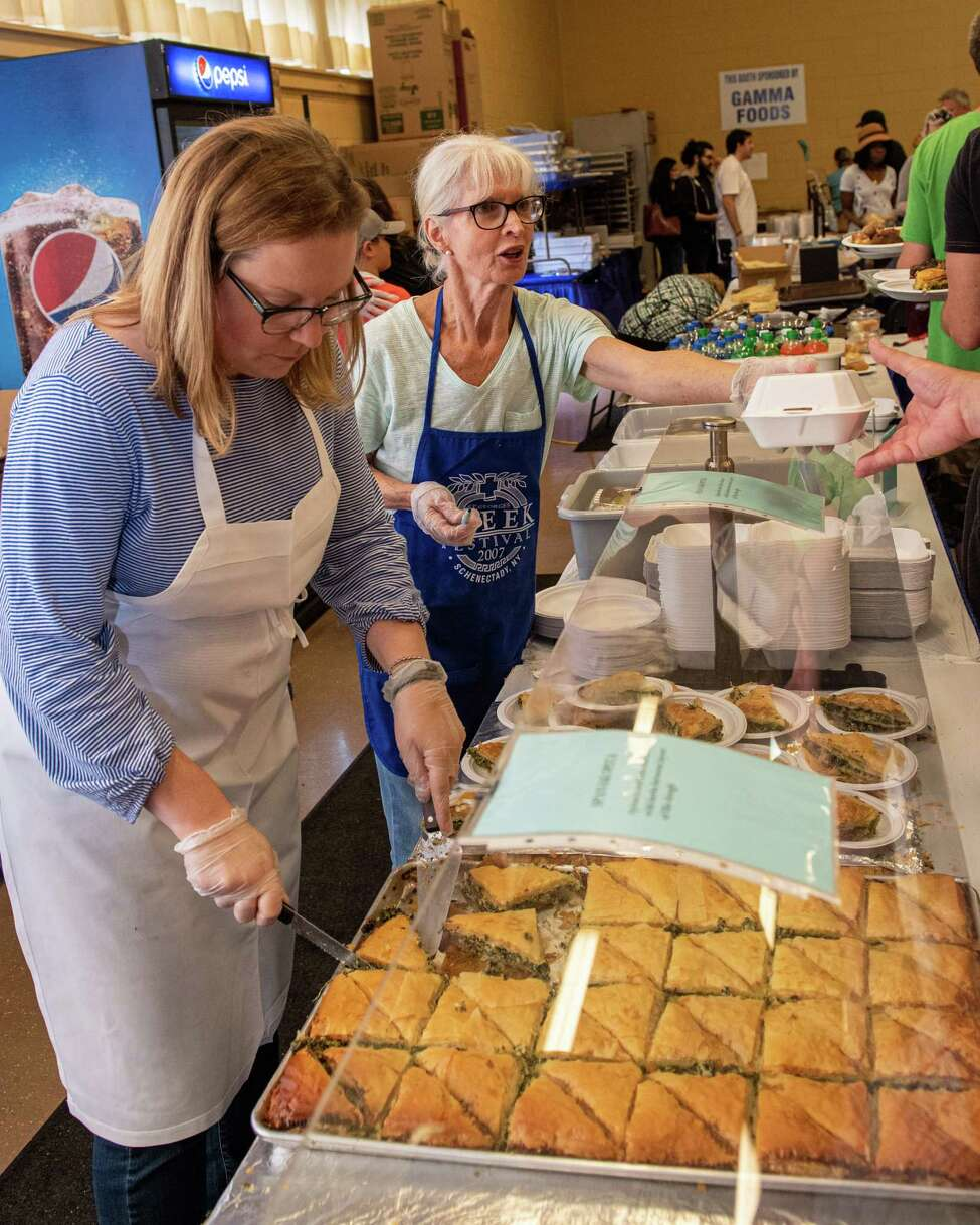 Jessica Mahar and Julie Mosher sell pastries at the 44th Annual St. Georgea€™s Greek Festival at the St. Georgea€™s Orthodox Church on Clinton Street in Schenectady on Saturday, Sept. 7, 2019 (Jim Franco/Special to the Times Union.)