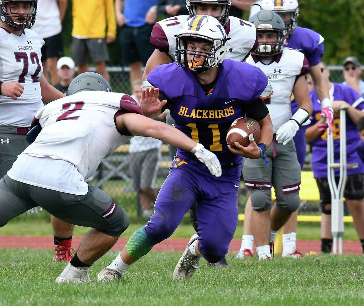 Photos from Week 1: Stillwater's Mason Seymour (2) defends against Voorheesville's Gavin Esposito (11) during the first half of a Section II High School football game Saturday, Sept. 7, 2019, in Voorheesville, N.Y. (Hans Pennink / Special to the Times Union)