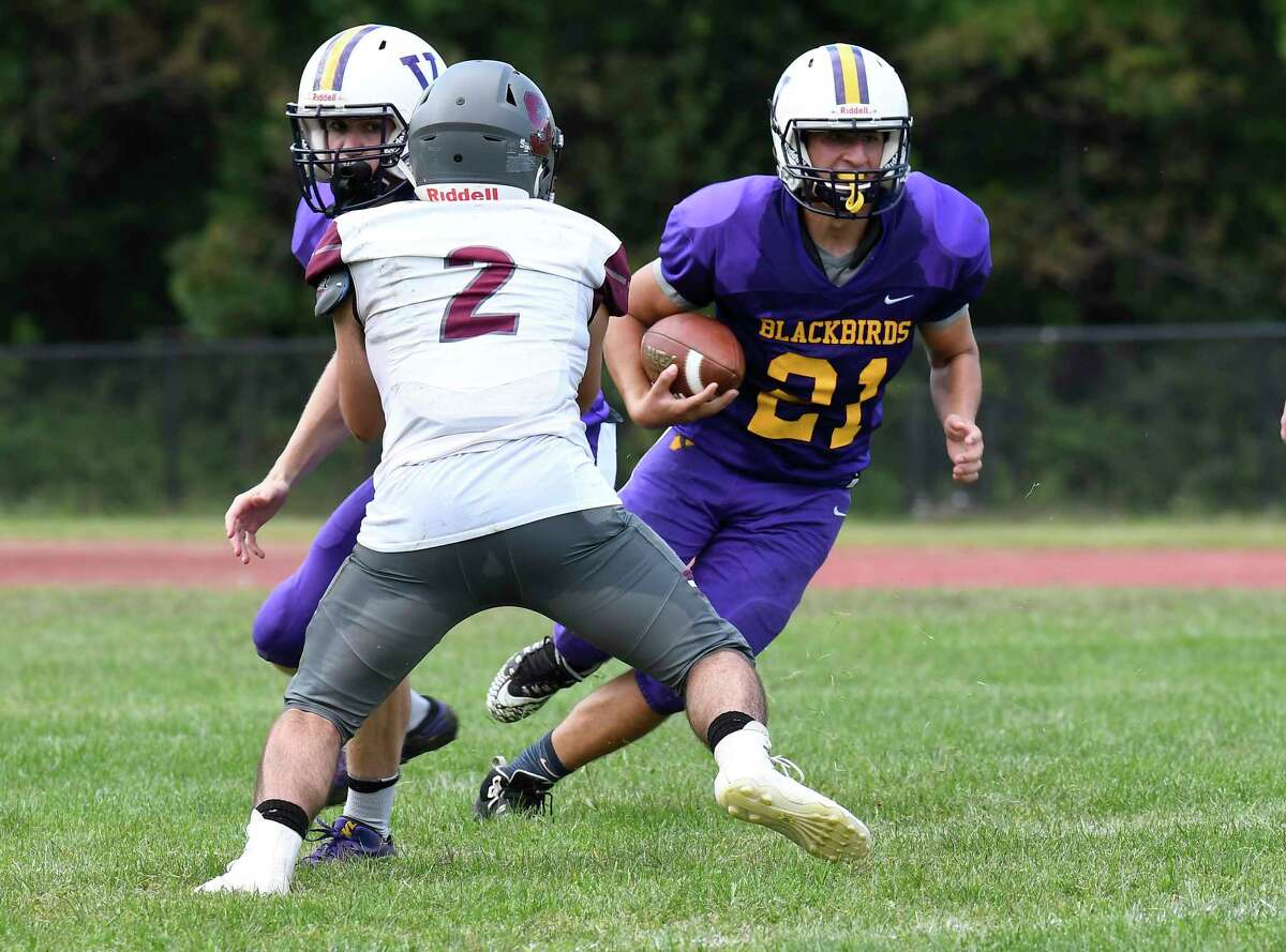 Stillwater's Mason Seymour (2) defends against Voorheesville's Joe Tomlin (21) during the first half of a Section II High School football game Saturday, Sept. 7, 2019, in Voorheesville, N.Y. (Hans Pennink / Special to the Times Union)