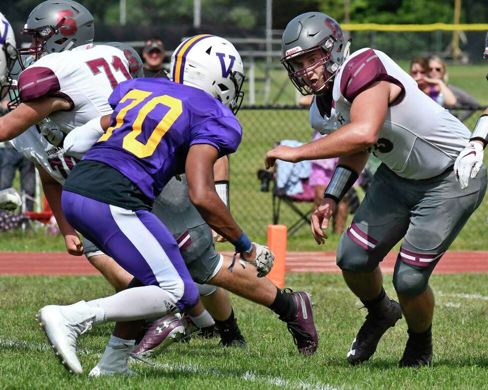 Stillwater's Brian McNeil ,right, defends against Voorheesville's Xavier Epps during the first half of a Section II High School football game Saturday, Sept. 7, 2019, in Voorheesville, N.Y. (Hans Pennink / Special to the Times Union)