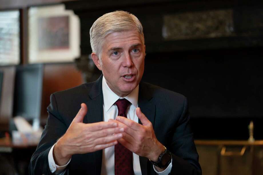 Associate Justice Neil Gorsuch, President Donald Trump's first appointee to the high court, speaks to The Associated Press about events that have influenced his life and the loss of civility in public discourse, in his chambers at the Supreme Court in Washington, Wednesday, Sept. 4, 2019. Gorsuch has written a new book on the importance of civics and civility, and a defense of his preferred originalism method of interpreting laws and the Constitution. (AP Photo/J. Scott Applewhite) Photo: J. Scott Applewhite / Copyright 2019 The Associated Press. All rights reserved.