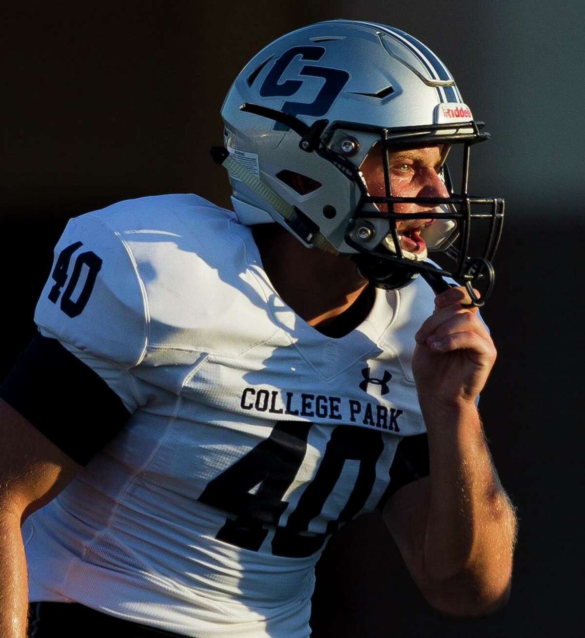 College Park linebacker Cade Rabson (40) call a defensive adjustment during the second quarter of a non-district high school football game at W.W. Thorne Stadium, Saturday, Sept. 7, 2019, in Houston.