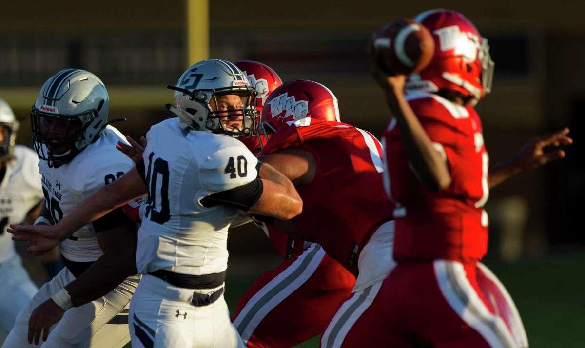College Park linebacker Cade Rabson (40) looks to sack Aldine MacArthur quarterback RaShaun Jackson (12) during the second quarter of a non-district high school football game at W.W. Thorne Stadium, Saturday, Sept. 7, 2019, in Houston.