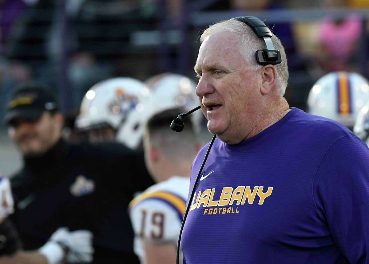 UAlbany football coach Greg Gattuso instructs his players against Bryant in 2019's home opener. This will be the first home game with fans for the Danes since Nov. 30, 2019.