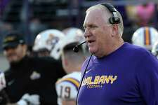 Albany Great Danes head coach Greg Gattuso instructs his players against the Bryant University Bulldogs during the first half of an NCAA college home opener football game Saturday, Sept. 7, 2019, in Albany, N.Y.