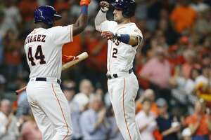 Houston Astros short stop Alex Bregman (2) celebrates his home run with designated hitter Yordan Alvarez (44) in the sixth inning at Minute Maid Park in Houston on Saturday, Sept. 7, 2019.