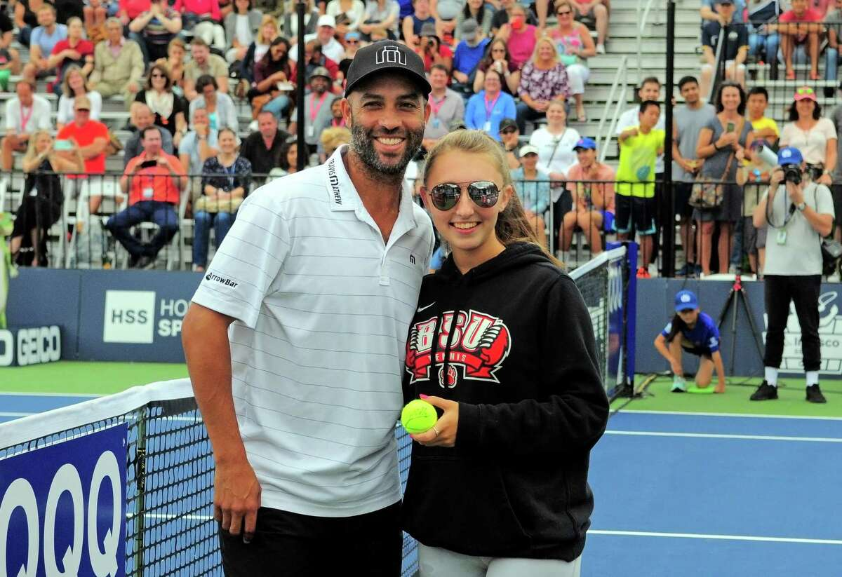 James Blake poses for a photo with volunteer Madison Butkus during the Oracle Champions Cup at Yale in New Haven, Conn., on Saturday Sept. 7, 2019. Blake played against Mark Philippoussis as part of the Men's Tennis Legends Series.