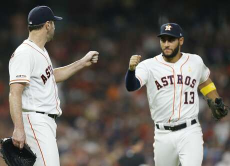 Houston Astros starting pitcher Justin Verlander (35) fist bumps Houston Astros third baseman Abraham Toro (13) after he got the last out in the seventh inning at Minute Maid Park in Houston on Saturday, Sept. 7, 2019.