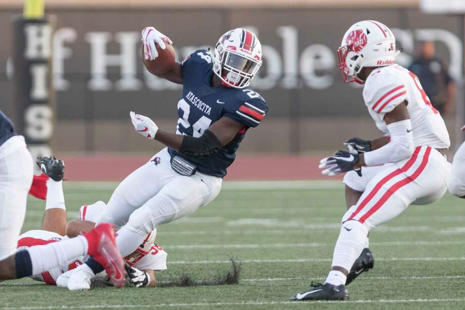 Atascocita running back Qunicy Thompson (24) is tackled for a loss by a Katy defender during the first half on Friday. Photo: Joe Buvid, Houston Chronicle / Contributor / © 2019 Joe Buvid