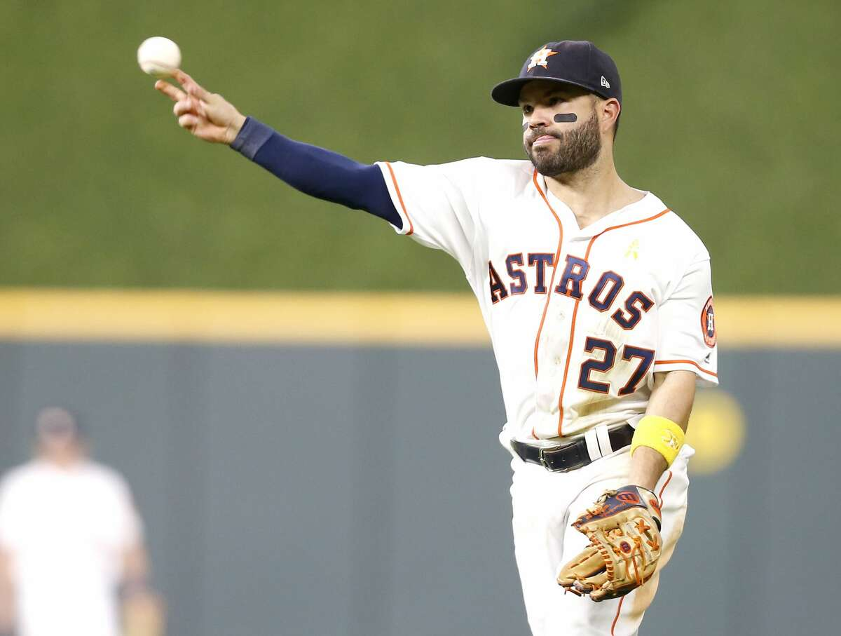 Houston Astros second baseman Jose Altuve (27) gets Seattle Mariners designated hitter Omar Narvaez (22) out for the second out in the ninth inning on Saturday, Sept. 7, 2019. Houston Astros won the game 2-1.