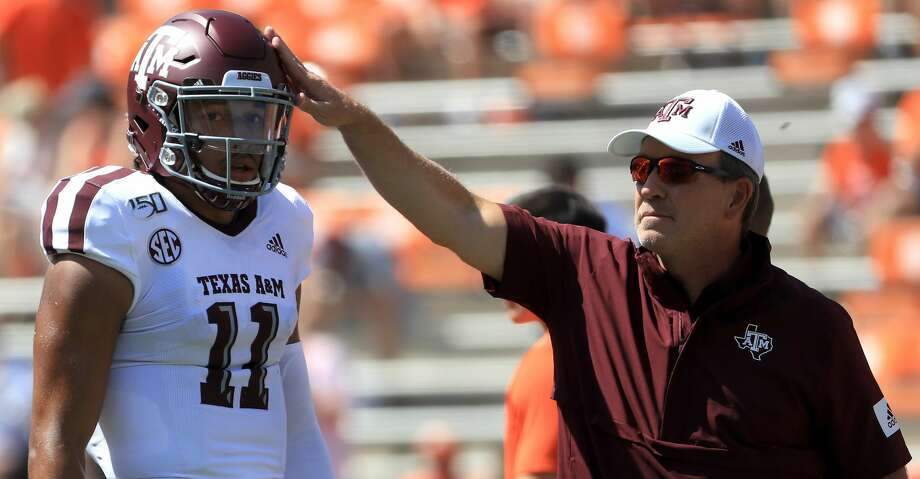 CLEMSON, SOUTH CAROLINA - SEPTEMBER 07: Head coach Jimbo Fisher stands alongside his quarterback Kellen Mond #11 of the Texas A&M Aggies before their game against the Clemson Tigers at Memorial Stadium on September 07, 2019 in Clemson, South Carolina. (Photo by Streeter Lecka/Getty Images) Photo: Streeter Lecka/Getty Images