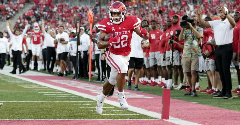 Houston running back Kyle Porter (22) score the first touchdown during the first half of an NCAA college football game Saturday, Sept. 7, 2019, in Houston, Texas. Photo: Michael Wyke/Contributor