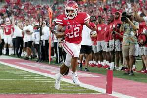 Houston running back Kyle Porter (22) score the first touchdown during the first half of an NCAA college football game Saturday, Sept. 7, 2019, in Houston, Texas.