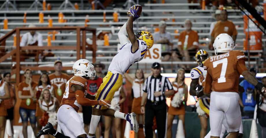LSU wide receiver Justin Jefferson (2) pulls in a catch for a touchdown over Texas defensive back Josh Thompson (29) during the first half of an NCAA college football game Saturday, Sept. 7, 2019, in Austin, Texas. (AP Photo/Eric Gay) Photo: Eric Gay/Associated Press