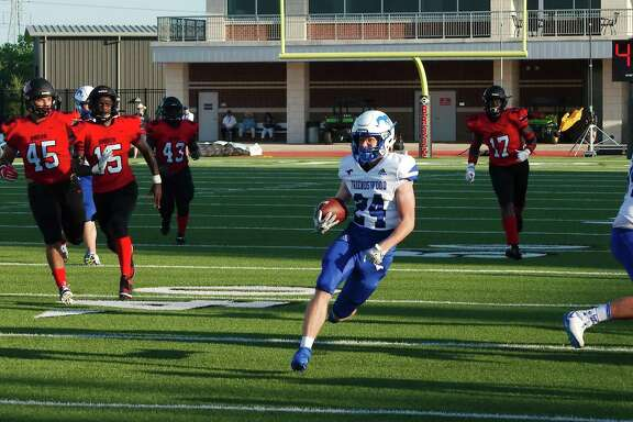 Friendswood's Joey Tomko (24) finds clear sailing in the Clear Brook defense Saturday at Challenger Columbia Stadium.