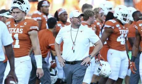 Sam Ehlinger walks nearby as coach Tom Herman gets his team ready pregame as Texas hosts LSU at Darrell K. Royal Stadium on September 7, 2019.