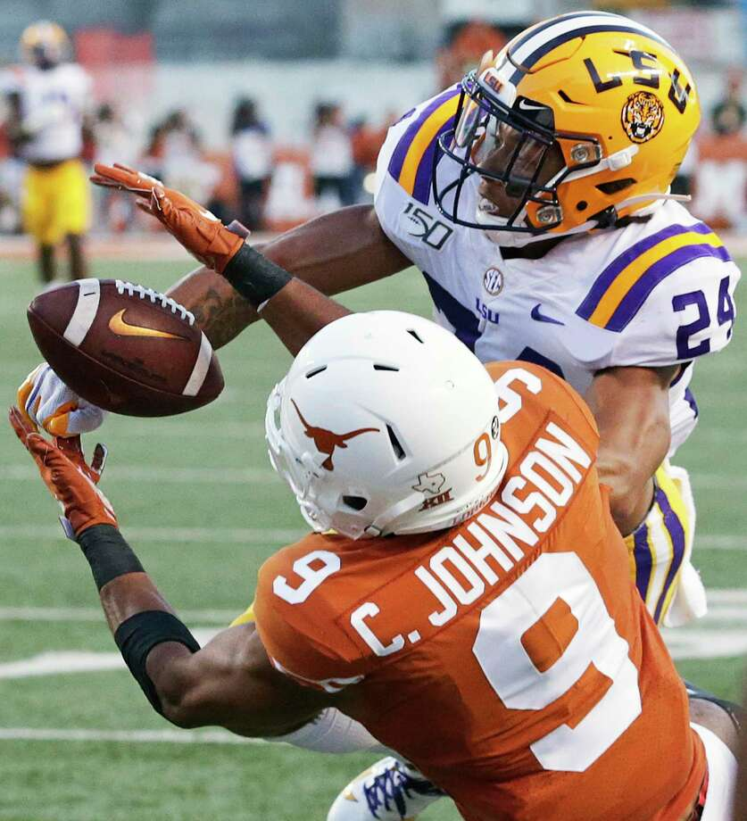 Longhorn receiver Collin Johnson battle to catch a long pass against Derek Stingley as Texas hosts LSU at Darrell K. Royal Stadium on September 7, 2019. Photo: Tom Reel, Staff / Staff Photographer / 2019 SAN ANTONIO EXPRESS-NEWS