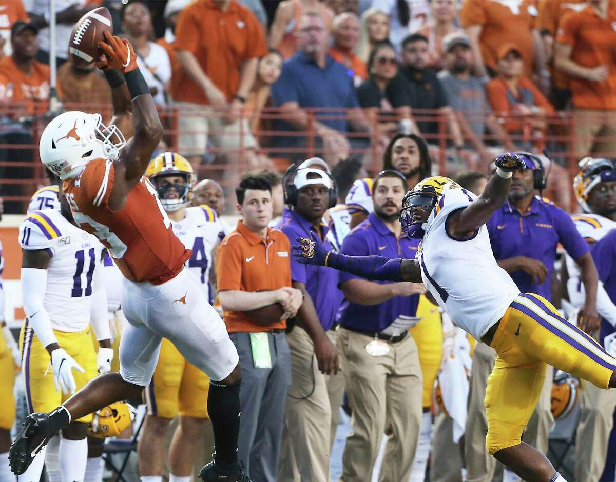 Longhorns receiver Brennan Eagles hauls in a touchdown pass behind LSU's Kristian Fulton in the first half of Saturday night's game at Darrell K Royal Stadium.