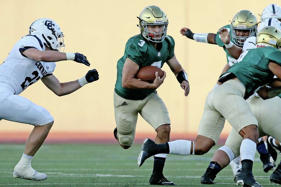 "Holy Cross quarterback Gilbert Salas III finds running room in the first half in the ""Holy Bowl"" high school football game with Central Catholic at Alamo Stadium on Saturday, Sept. 7, 2019. / Express-News 2019"