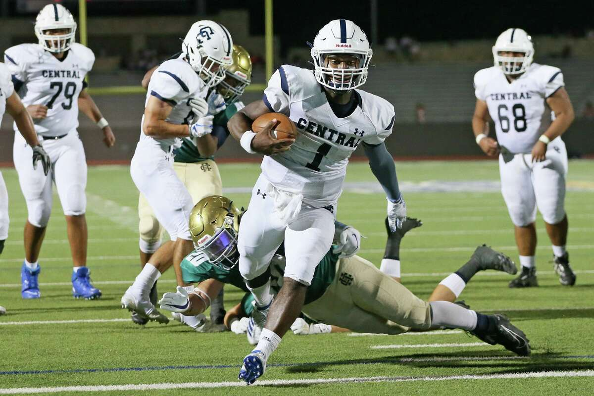 Central Catholic quarterback Christian Allen runs past Holy Cross Jacob Olivares for a five-yard touchdown in the second half in the